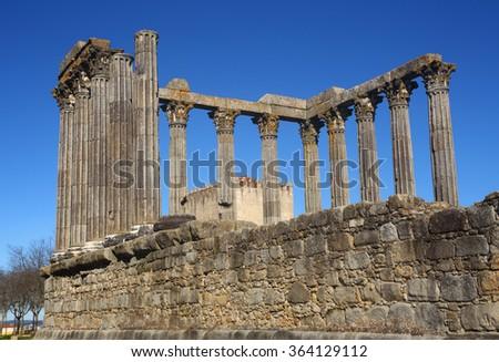 Portugal, Alentejo Region, Evora Historic center. Granite stone columns of  the Temple of Diana - Roman remains UNESCO World Heritage site. - stock photo