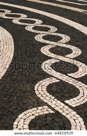 Portugal Azores Islands Sao Miguel typical black and white mosaic stone pavement  in the historic center of the  capital Ponta Delgada - stock photo