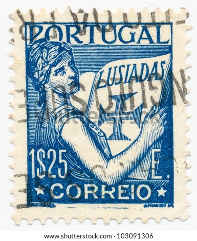 PORTUGAL - CIRCA 1931: A stamp printed in Portugal shows Portugal Holding Volume of  Lusiads, circa 1931