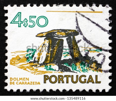 PORTUGAL - CIRCA 1974: a stamp printed in the Portugal shows Dolmen of Carrazeda, Prehistoric Construction, circa 1974