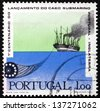 PORTUGAL - CIRCA 1970: a stamp printed in the Portugal shows Paddlesteamer Great Eastern Laying Cable, Centenary of the Portugal - Great Britain Submarine Telegraph Cable, circa 1970 - stock photo