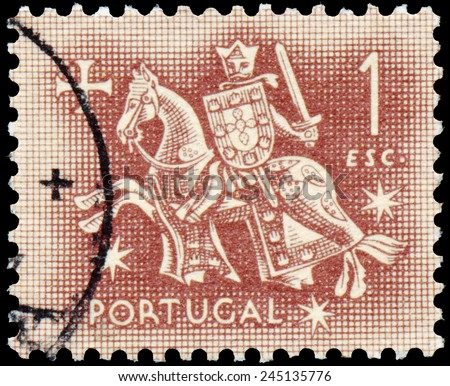 PORTUGAL - CIRCA 1953: Stamp printed in Portugal with image of a medieval knight on a horse, circa 1953. - stock photo