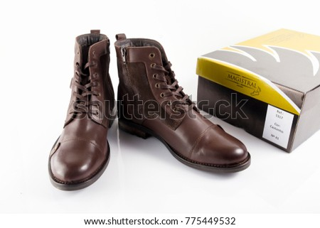 Portugal, December 15, 2017:Olivier casual shoe. Olivier, Multinational company. Isolated on White. Product shots.