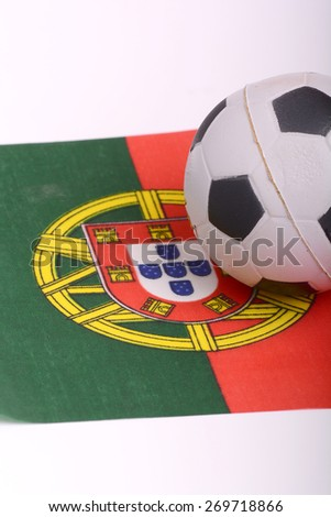 Portugal flag with old championship soccer ball - stock photo