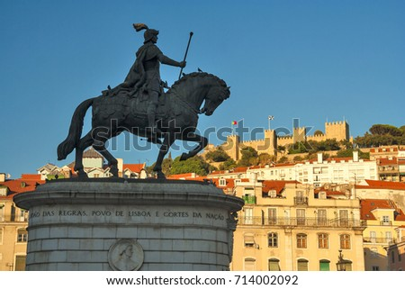 Portugal - Lisbon - Equestrian monument of John I (Joao I), medieval king of Portugal and of the Algarve, on the praca de Figueira (fig tree square) with St George castle on background