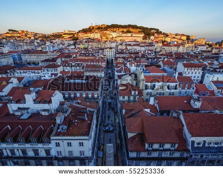 Portugal, Lisbon, Miradouro de Santa Justa, View over downtown and Santa Justa Street towards the castle hill at sunset.