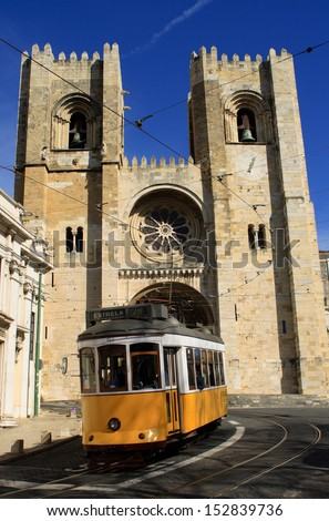 Portugal Lisbon, Patriarchal Cathedral of Saint Mary Major - Santa Maria Maior de Lisboa, also known as the Sa, with famous 'No 28' traditional electric tram descending. - stock photo