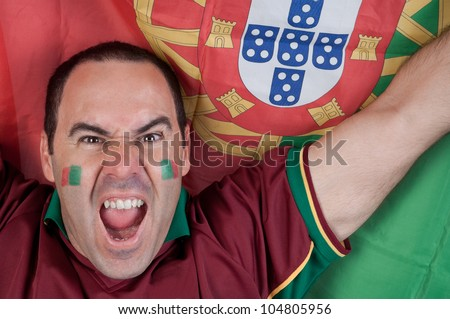 Portugal soccer fan with the portuguese flag - stock photo