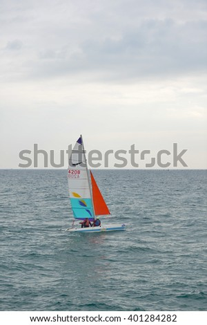 Portugal, Vilamoura - 06 February 2016: young sailors sailing during 42 th Carnival Regatta from CIMAV. Ocean outdoors background