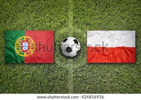 Portugal vs. Poland flags on a green soccer field - stock photo