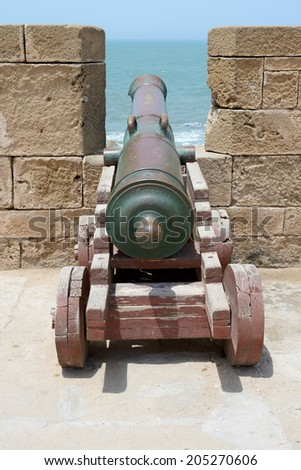 Portuguese cannon in fortress battlements facing the sea - stock photo