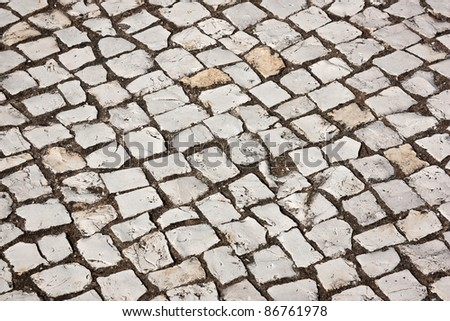 Portuguese cobblestone sidewalk made of cubic stones