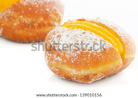 Portuguese doughnuts or Berliners with egg creme over white background - stock photo