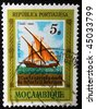 PORTUGUESE EMPIRE - CIRCA 1960: A five dollar stamp printed in Mozambique, part of the Portuguese Empire at the time, shows image of a ship, circa 1960 - stock photo