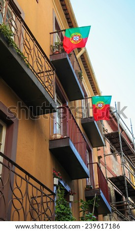 Portuguese flags in the old center of Porto, Portugal. - stock photo