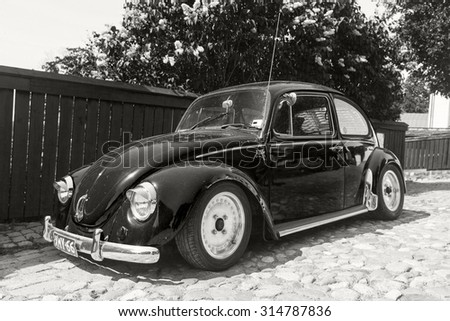 Porvoo, Finland - June 12, 2015: The very last Volkswagen Beetle modification is parked on the street of Porvoo - stock photo