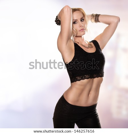 Pose of a sexy blonde dressed in black - stock photo
