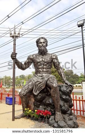 Poseidon with Trident made of iron . - stock photo
