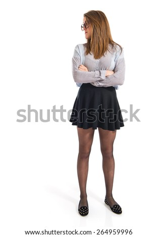 Posh girl with her arms crossed  - stock photo