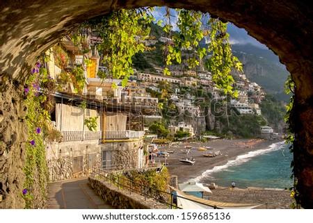 Positano beach through archway - stock photo