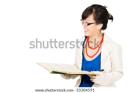 Positive asian woman in glasses reading and laugh - stock photo