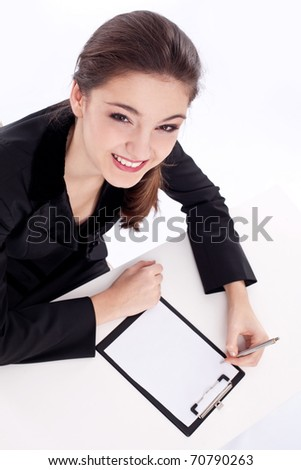 Positive bank official. Young woman sitting at the table. - stock photo
