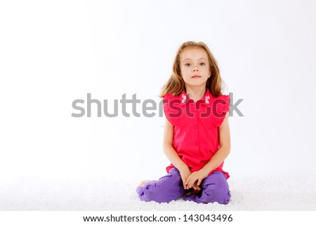Positive beautiful girl on a white background