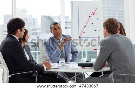 Positive business group having a meeting in a company - stock photo