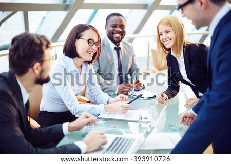 Positive business team working at office - stock photo