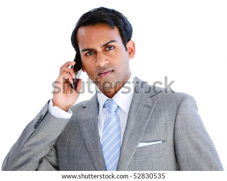 Positive businessman taking a phone call in  the office - stock photo