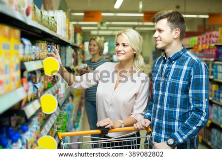 positive clients buying additive-free baby foods in supermarket - stock photo