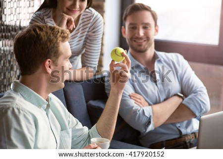 Positive colleagues having a conversation  - stock photo