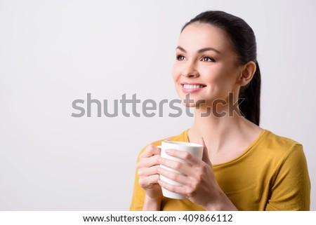 Positive content girl drinking tea - stock photo
