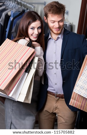 Positive couple is in the shop - stock photo