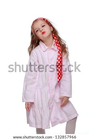Positive emotional little girl in the image of the girl of the sixties on white background
