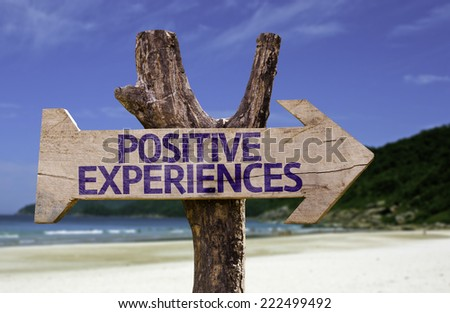 Positive Experiences wooden sign with a beach on background - stock photo