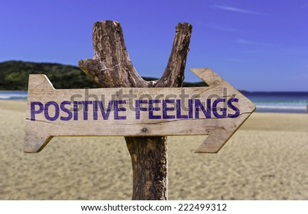 Positive Feelings wooden sign with a beach on background - stock photo