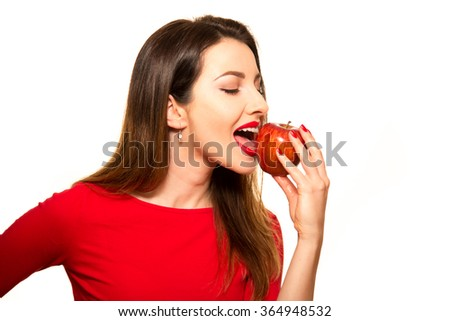 Positive Female Biting a Big Red Apple Fruit Smiling on White Biting - stock photo