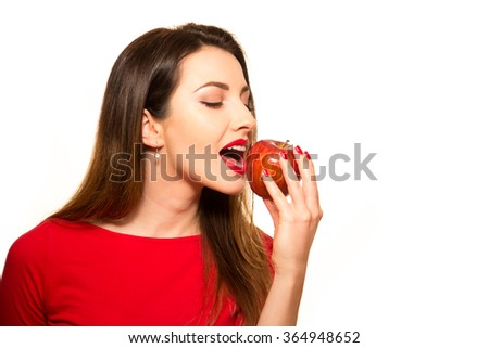 Positive Female Biting a Big Red Apple Fruit Smiling on White Eating - stock photo