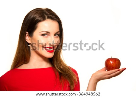 Positive Female Biting a Big Red Apple Fruit Smiling on White Holding - stock photo