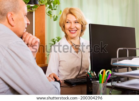 Positive  female doctor discussing with senior patient his options