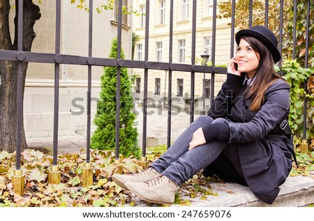 Positive female talking on cell phone and smile,selective focus  - stock photo