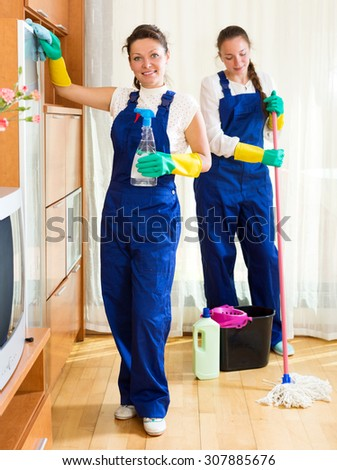 Positive female workers cleaning company ready to start work