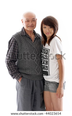 positive image of an asian grandfather with his granddaughter - stock photo