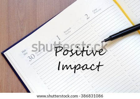 Positive impact text concept write on notebook with pen