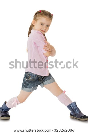 Positive little girl wearing a pink sweater and denim shorts.-Isolated on white background