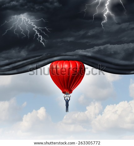 Positive outlook and recovery concept as a person or businessman riding a red hot air balloon lifting the dangerous dark stormy skies to reveal a blue sky as a mindset symbol. - stock photo