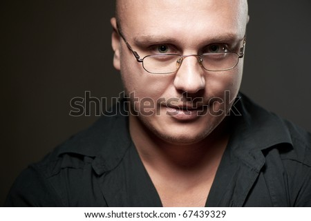 Positive portrait of serious man in eyeglasses