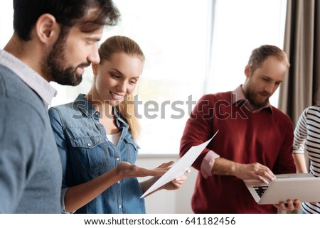 Positive pretty female explaining information to her friend