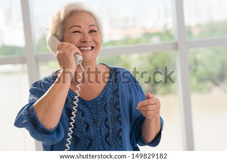 Positive senior woman talking on the phone - stock photo